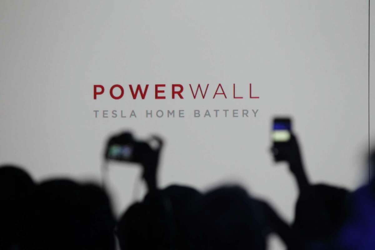 Media members and guests wait for the Tesla Motors Inc. to announce its expansion into the home battery market in Hawthorne, Calif., Thursday, April 30, 2015. Tesla CEO Elon Musk is trying to steer his electric car company's battery technology into homes and businesses as part of an elaborate plan to reshape the power grid with millions of small power plants made of solar panels on roofs and batteries in garages. (AP Photo/Ringo H.W. Chiu)