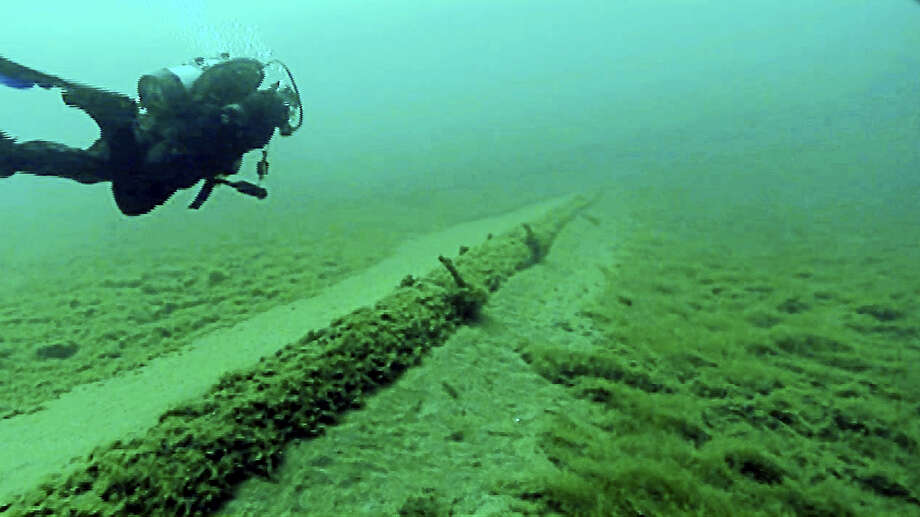 A diver for the National Wildlife Federation inspects the Enbridge Line 5 pipeline under the Straits of Mackinac in 2013. Each day, some 540,000 barrels of light crude oil and natural gas liquids roar through en route from the shale oil wells of Alberta to refineries in Detroit and Sarnia, Ontario. Photo: Courtesy Of The National Wildlife Federation / HANDOUT