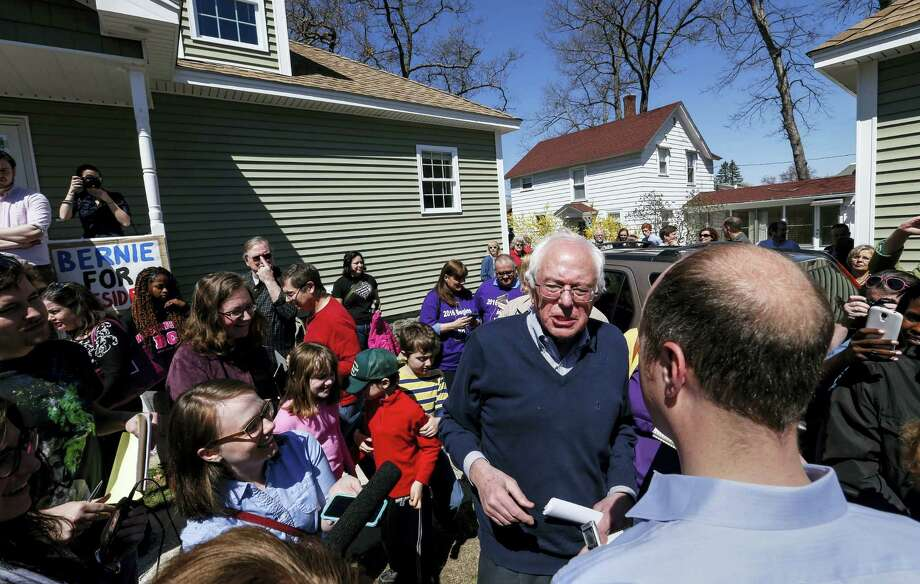 Presidential hopeful Sen. Bernie Sanders gives brief media interviews after speaking at a house party in Manchester, N.H., Saturday, May 2, 2015. Sanders discussed economic issues facing the country. Photo: AP Photo/Cheryl Senter / FR62846 AP