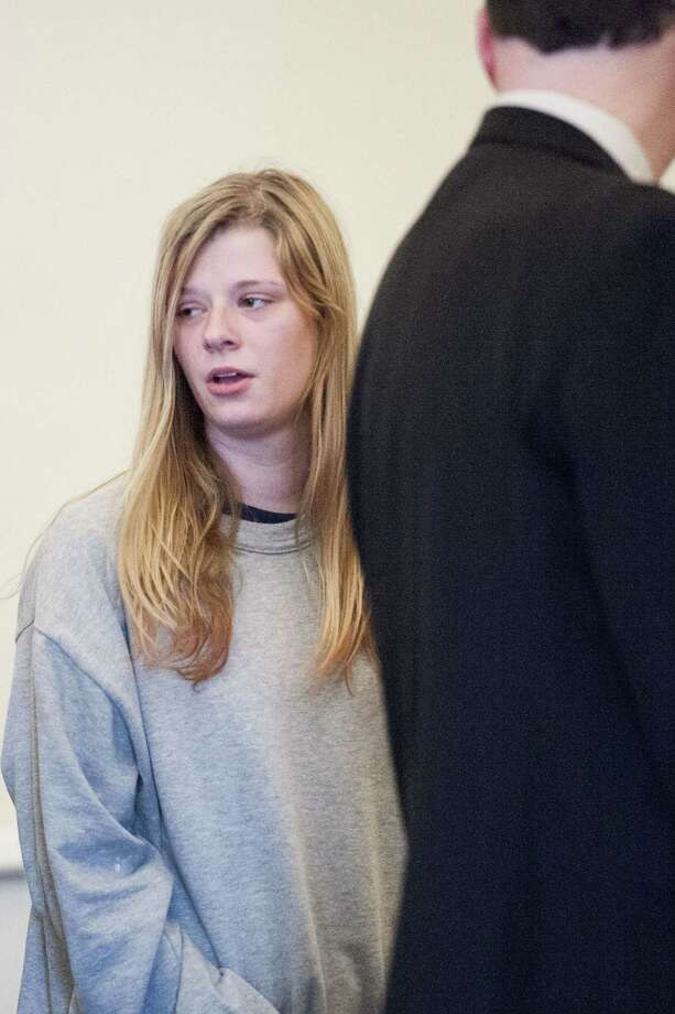 Heather Birden looks back at her family moments before she is charged with murder in Litchfield Superior Court on Friday. The 20-year-old is accused of killing Holly Aeschlimann, 19, on April 17, in Torrington. Photo: Erin Covey — The Republican-American Via AP, Pool  / Republican-American