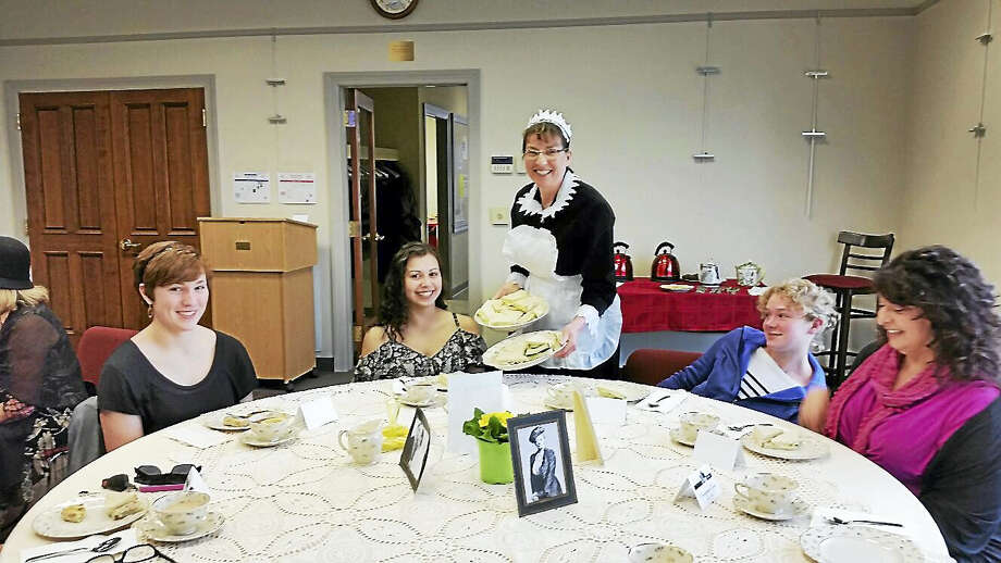 "Teen librarian Sara Lo Presti served Megan Porga, 16; Meghan Conlin, 16; Emily Porga, 14; and Lisa Conlin, all of Burlington, while dressed in a period costume at the ""Downton Abbey"" Tea Party at the Burlington Public Library at 34 Library Lane in Burlington on Saturday afternoon. Photo: N.F. Ambery — The Register Citizen"