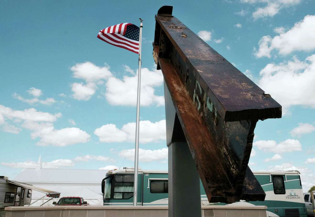 """This Sept. 3, 2016, photo shows a beam from the destroyed World Trade Center buildings, part of the 9/11 Memorial near the Veterans' Pavilion at the Fulton County Fair, in Wauseon, Ohio. """"We just don't know where the events of 9/11 have lead us,"""" said Rick Sluder, fire chief in Wauseon, Ohio, which obtained the beam and, together with neighboring departments, built the memorial. """"A lot of people are looking at this as, is this point of downfall or the point at which we rose above the rest, the point of resiliency?"""" Sluder said. """"I don't think that's been determined yet."""""""