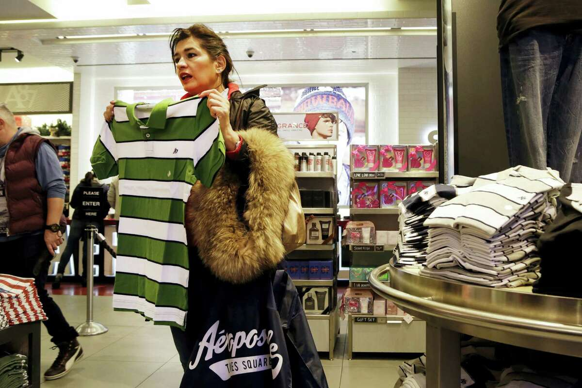 In this Dec. 2, 2015, photo, a woman shops in an Aeropostale clothing store in New York.