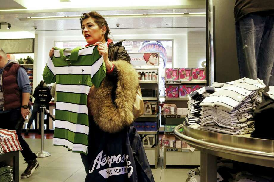 In this Dec. 2, 2015, photo, a woman shops in an Aeropostale clothing store in New York. Photo: Mark Lennihan — The Associated Press  / Copyright 2016 The Associated Press. All rights reserved. This material may not be published, broadcast, rewritten or redistribu