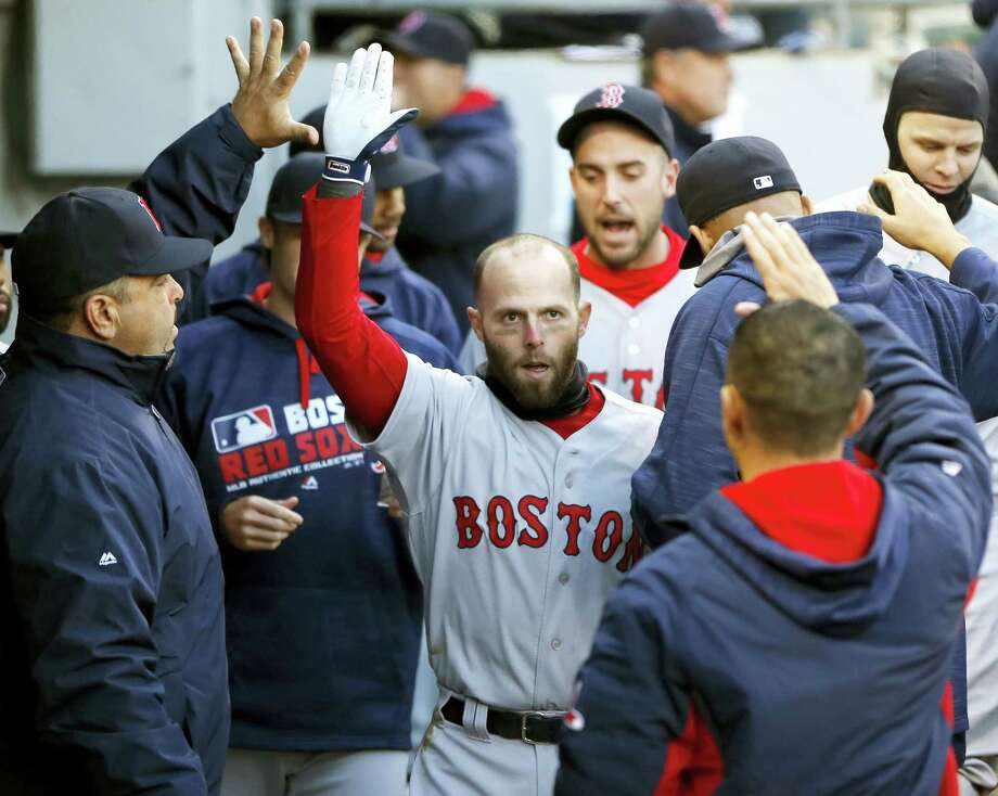 Boston Red Sox's Dustin Pedroia celebrates his home run off Chicago White Sox starting pitcher Erik Johnson in the dugout during the first inning of a baseball game, Thursday, May 5, 2016, in Chicago. (AP Photo/Charles Rex Arbogast) Photo: AP / Copyright 2016 The Associated Press. All rights reserved. This material may not be published, broadcast, rewritten or redistribu