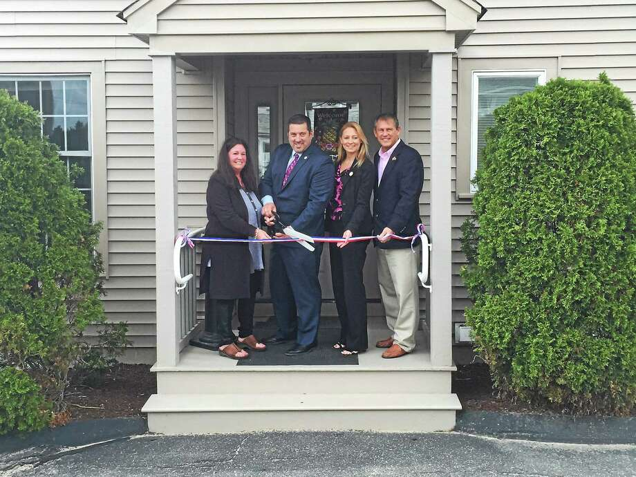 Nancy Cannavo of Charlotte Hungerford Hospital, state Reps. Jay Case and Michelle Cook, and state Sen. Kevin Witkos at the ribbon-cutting ceremony that marked the official opening of The Gathering Place in Torrington. Photo: Ben Lambert — The Register Citizen