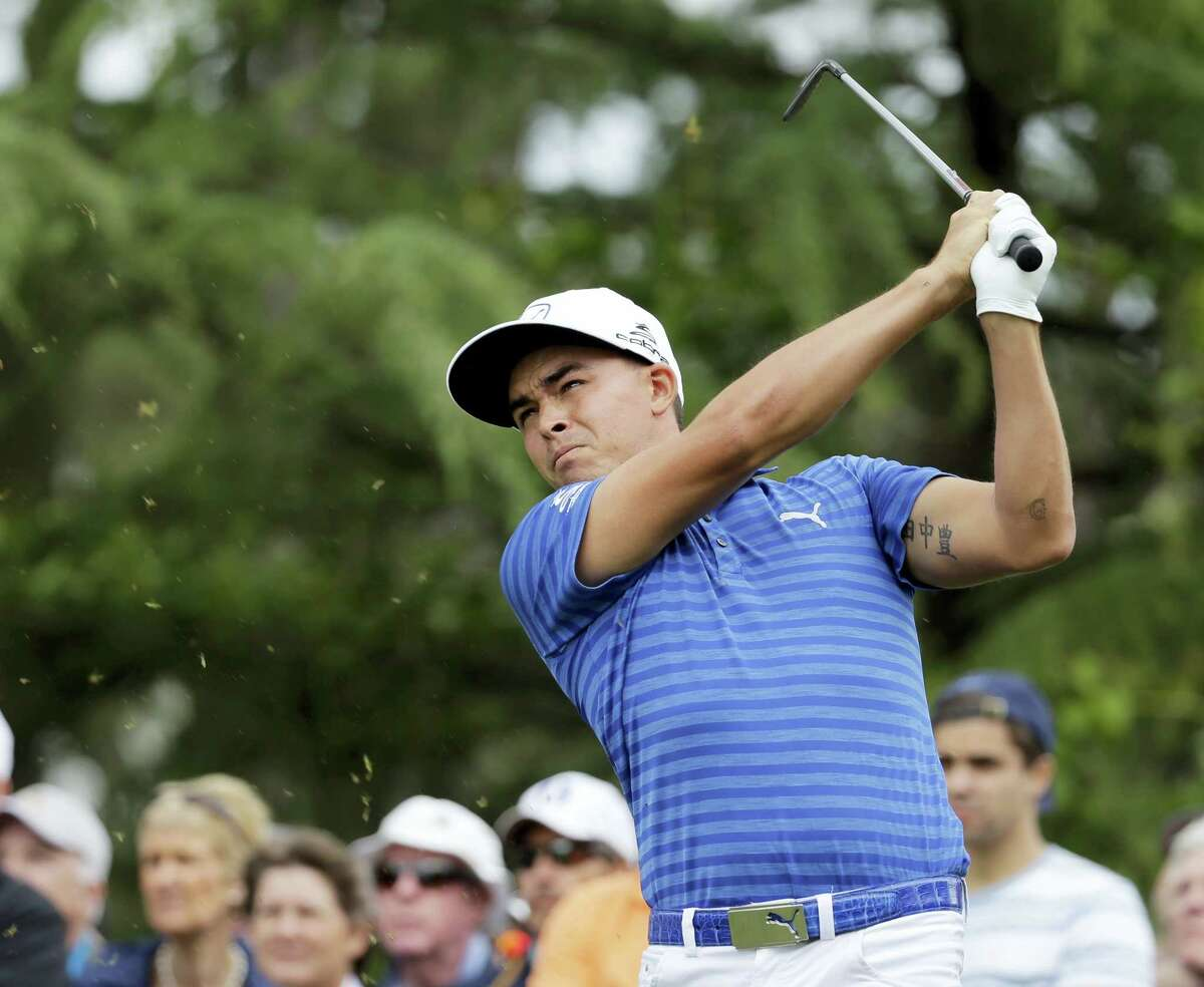 Rickie Fowler watches his tee shot on the second hole during the second round of the Wells Fargo Championship golf tournament at Quail Hollow Club in Charlotte, N.C., Friday. Fowler is three strokes behind leader Andrew Loupe.