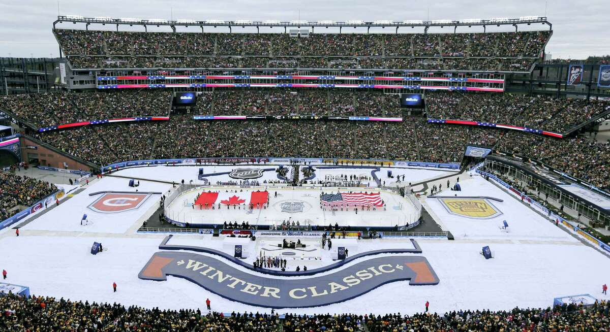 The Canadian and American flags are presented during the national anthems prior the Winter Classic between the Bruins and Canadiens on Friday at Gillette Stadium in Foxborough, Mass.