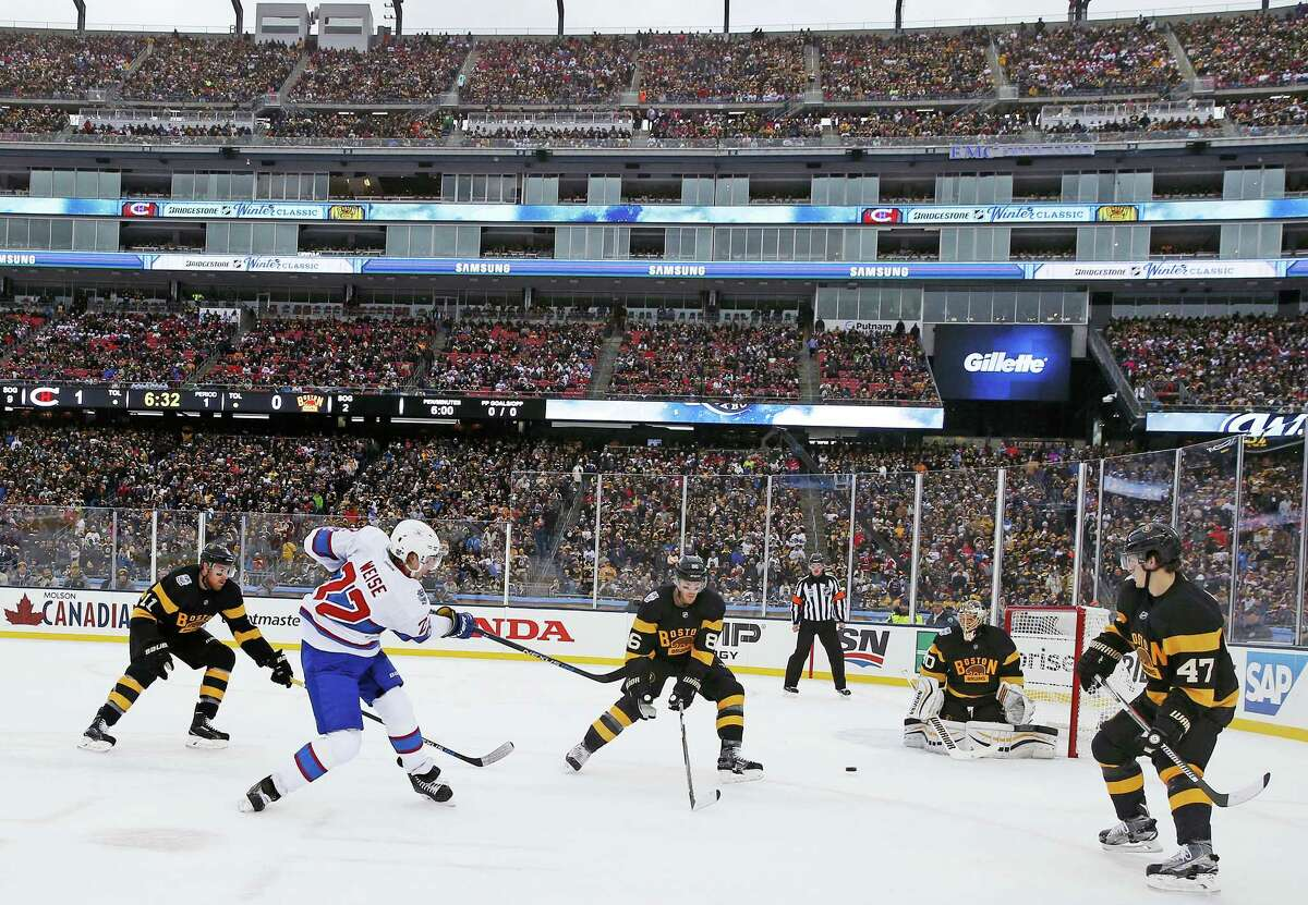 Canadiens right wing Dale Weise (22) takes a shot on Bruins goalie Tuukka Rask during the first period of the Winter Classic on Friday at Gillette Stadium in Foxborough, Mass.