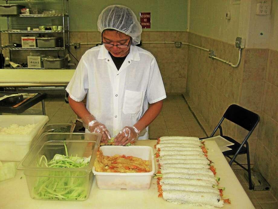 Chef Zarni prepares sushi at Edo Sushi Express in Watertown. Photo: Photos By John Torsiello