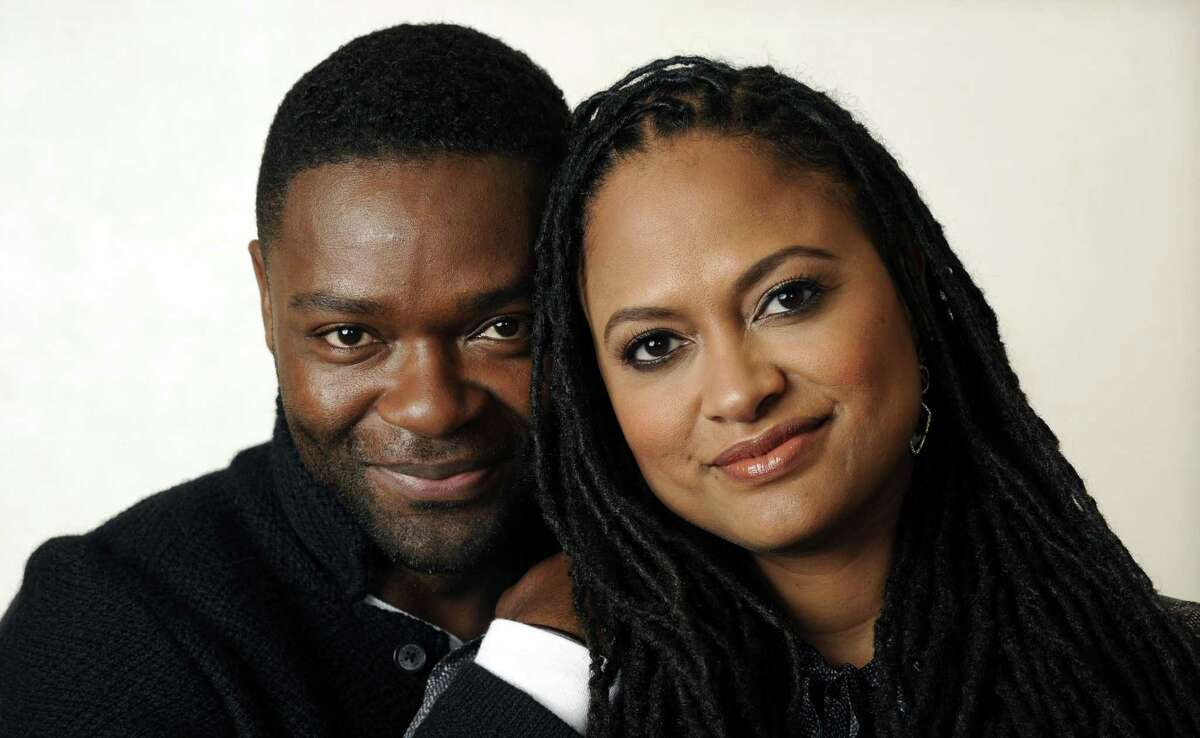 """In this Wednesday, Nov. 12, 2014 photo, Ava DuVernay, right, director of the film """"Selma,"""" and cast member David Oyelowo pose together at the Four Seasons Hotel in Los Angeles. DuVernay's film, which opens in limited release on Christmas Day and wide on Jan. 9, 2015, is earning her raves and awards buzz. (Photo by Chris Pizzello/Invision/AP)"""