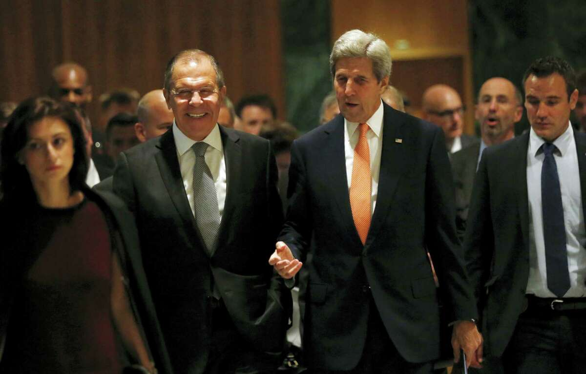 U.S. Secretary of State John Kerry, left, and Russian Foreign Minister Sergey Lavrov, walk in to their meeting room in Geneva, Switzerland, Friday, Sept. 9, 2016, to discuss the crisis in Syria.