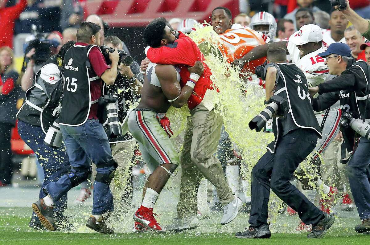 Ohio State head coach Urban Meyer is held by running back Ezekiel Elliott as he is dunked with Gatorade at the end of the Buckeyes' 44-28 Fiesta Bowl win over Notre Dame on Friday in Glendale, Ariz.