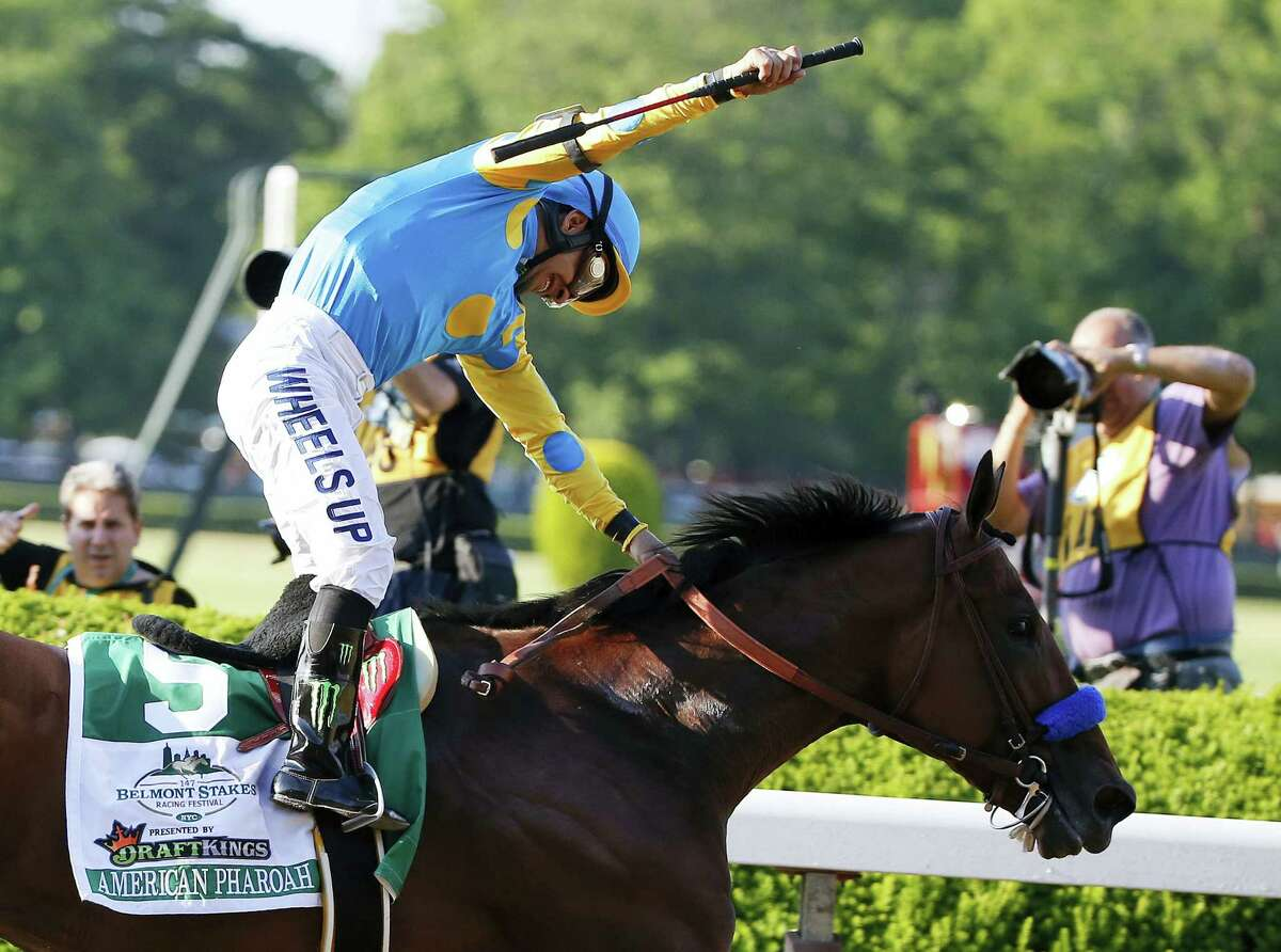 In this June 6 file photo, Victor Espinoza reacts after guiding American Pharoah across the finish line to win the Belmont Stakes at Belmont Park in New York.