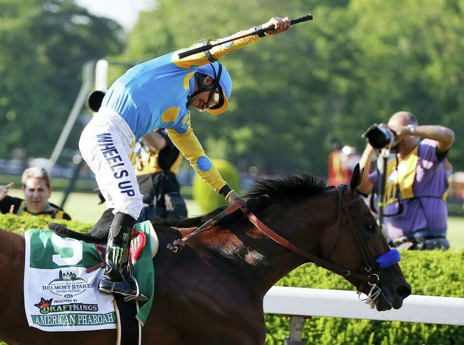 In this June 6 file photo, Victor Espinoza reacts after guiding American Pharoah across the finish line to win the Belmont Stakes at Belmont Park in New York. Photo: Kathy Willens — The Associated Press File Photo  / AP
