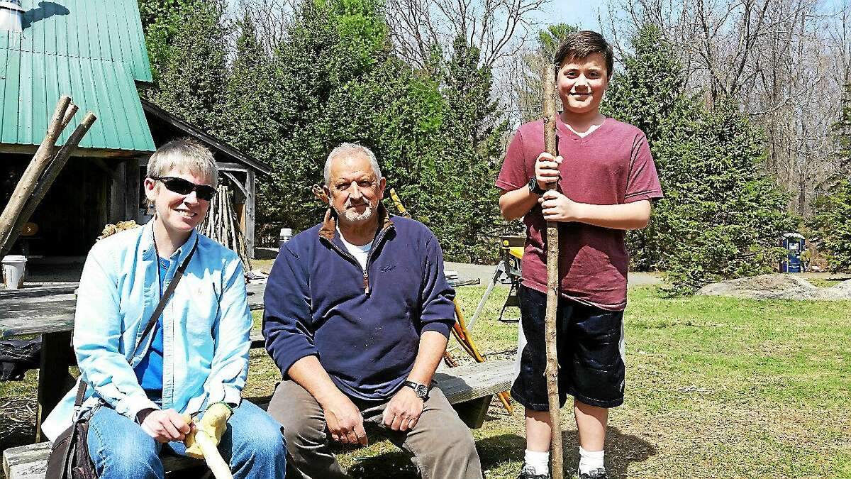 Linda Miller of New Milford, Connecticut Woodcarvers Association member Michael Audette of Thomaston, and Ryan Harrison, 11, of Torrington, attend an informal all-day wood carving presentation and workshop at the Flanders Nature Center in Woodbury on Sunday.