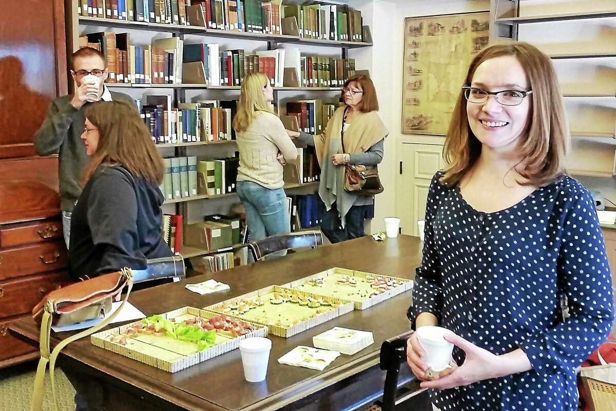 Artist Brie McDonald is pictured at the opening reception of her painting and collage show at the Gunn Memorial Library at 5 Wykeham Road in Washington on Nov. 22.