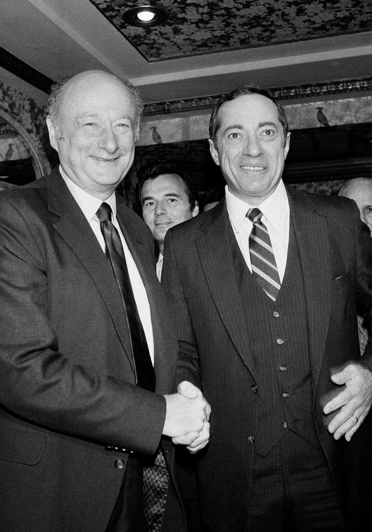 FILE - In this Sept. 21, 1982, file photo, New York Democratic gubernatorial candidates, New York Mayor Edward Koch, left, and New York Lt. Gov. Mario Cuomo, shake hands before starting their debate in New York. Cuomo, a three-term governor of New York, died Thursday, Jan. 1, 2015, the day his son Andrew started his second term as governor, the New York governor's office confirmed. He was 82.