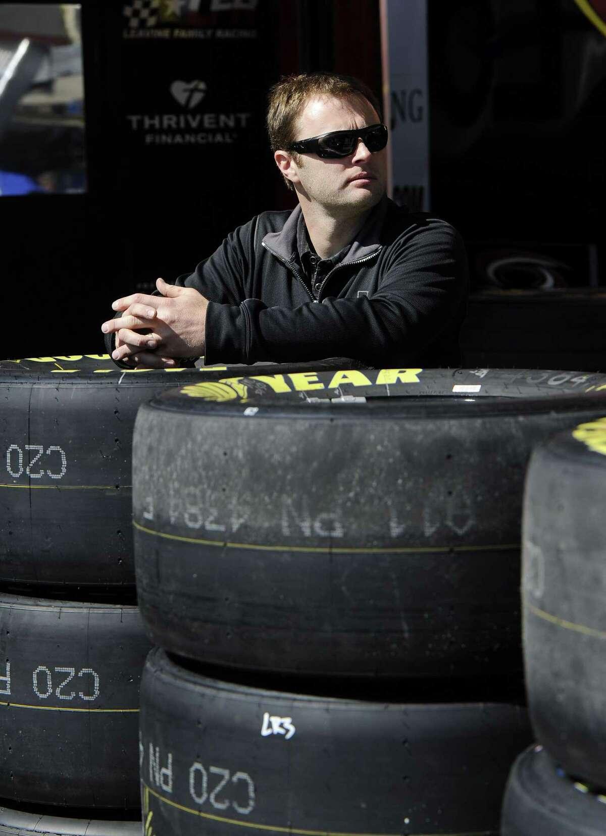 NASCAR driver Travis Kvapil waits in the garage Friday at Atlanta Motor Speedway.
