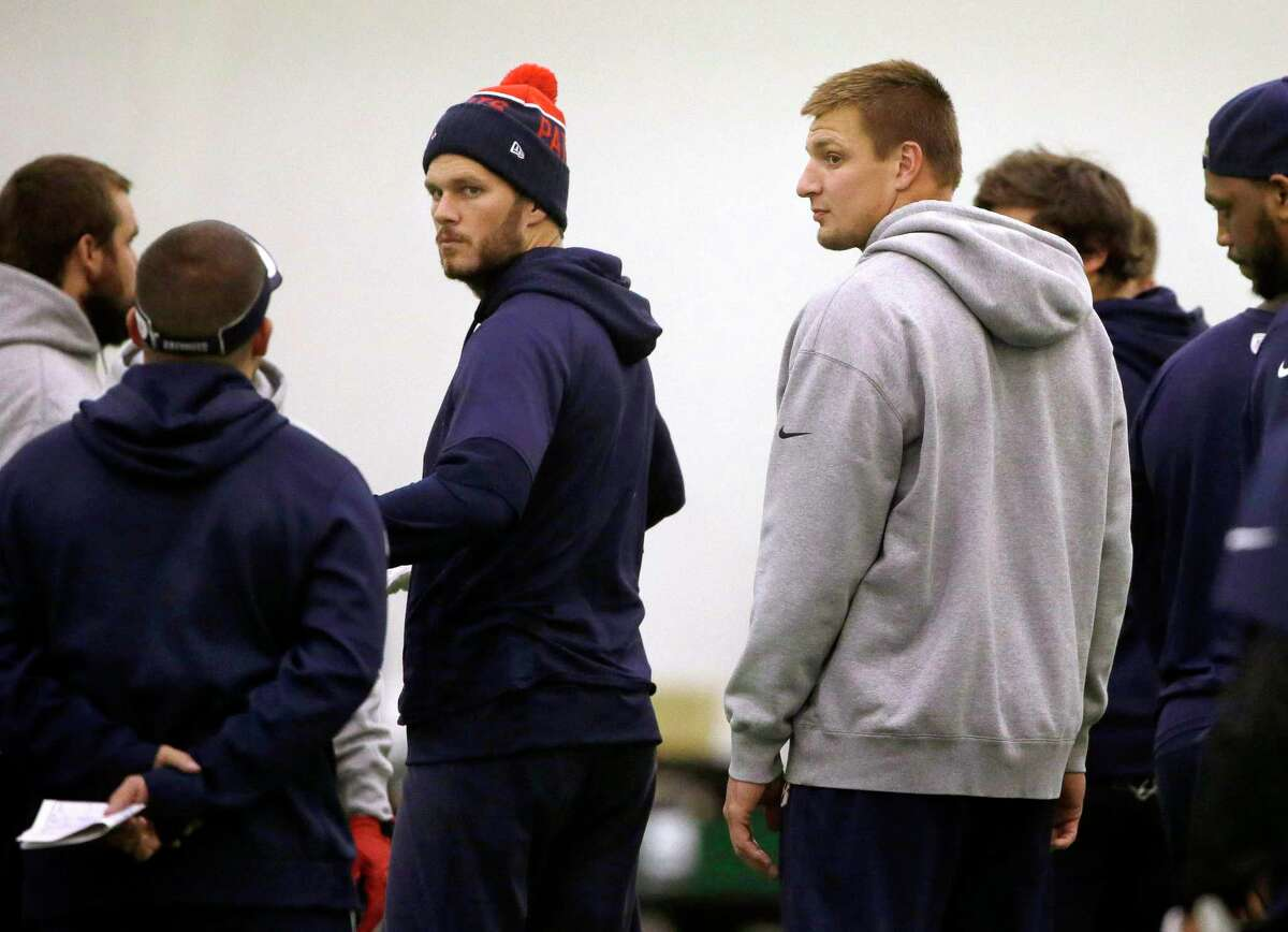 New England Patriots quarterback Tom Brady, center left, and tight end Rob Gronkowski, center right, participate in practice Tuesday in Foxborough, Mass.