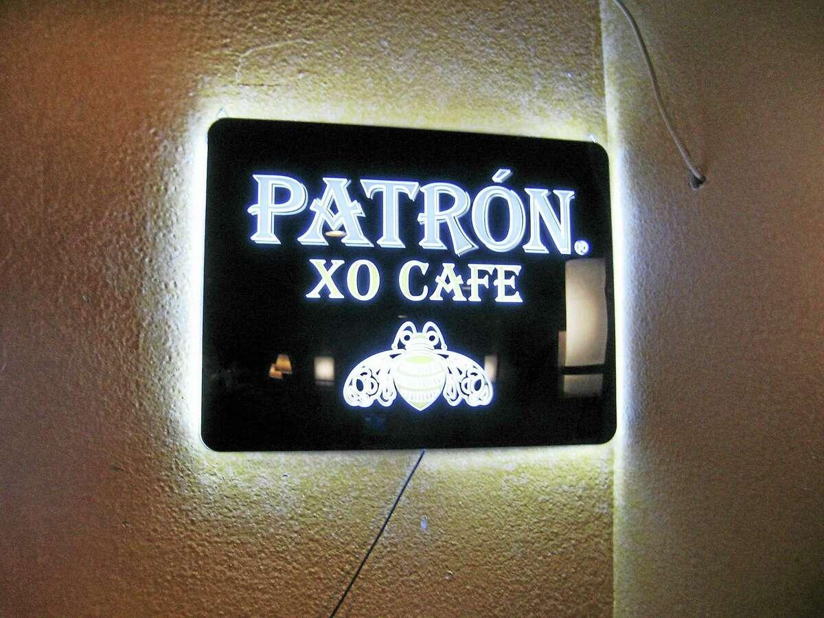 A sign in the bar area at Dos Amigos.