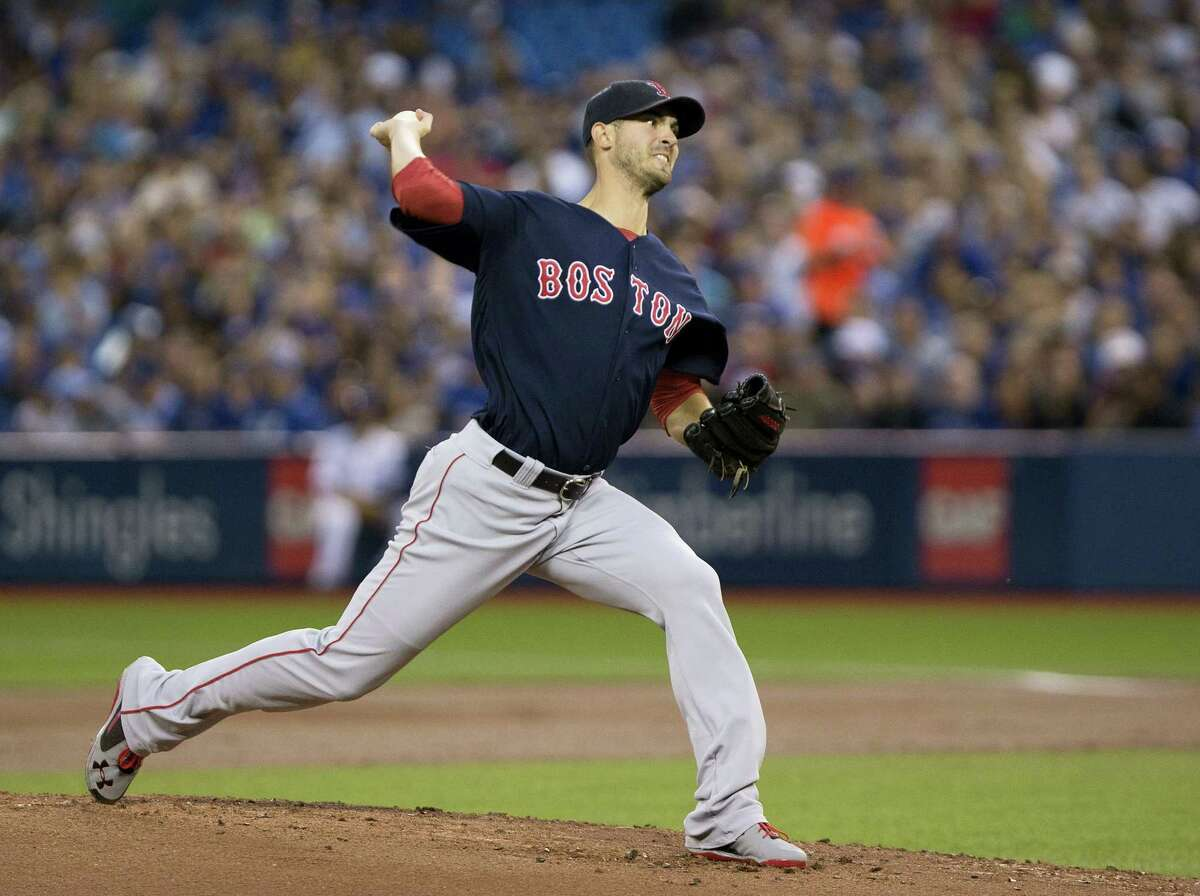 Red Sox starting pitcher Rick Porcello delivers in the first inning against the Blue Jays on Friday.