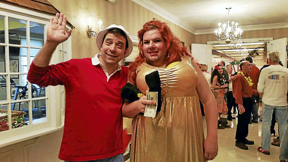 """Ian Campbell as Gilligan and DJ Murphy as Ginger from the 1960s sitcom """"Gilligan's Island"""" posed after their spoof skit at the 26th annual Possum Queen Festival at the Litchfield Inn on Friday afternoon. Photo: Photo By N.F. Ambery"""