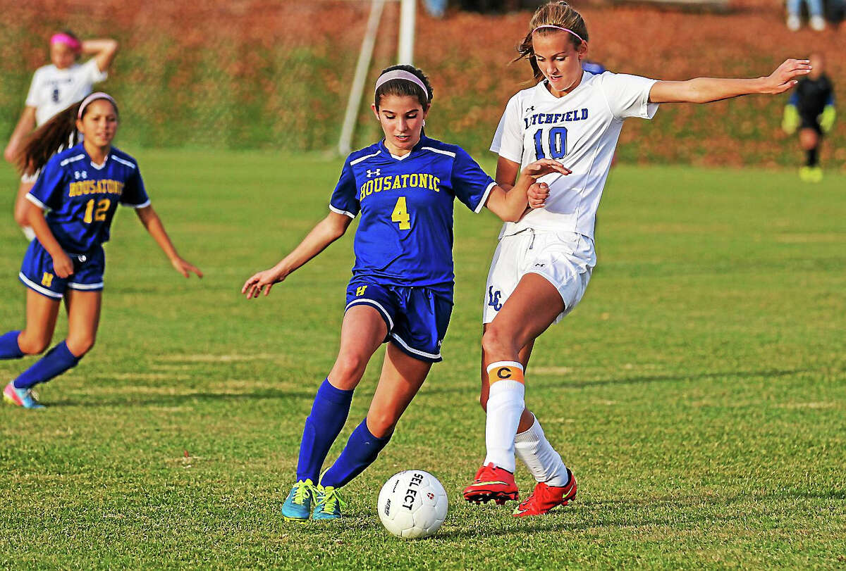 Litchfield's Elena Kennedy attempts to take control of the ball from Josie Horosky of Housatonic.