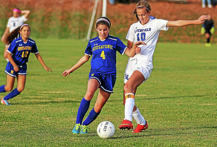 Litchfield's Elena Kennedy attempts to take control of the ball from Josie Horosky of Housatonic. Photo: Marianne Killackey – Special To Register Citizen  / 2015