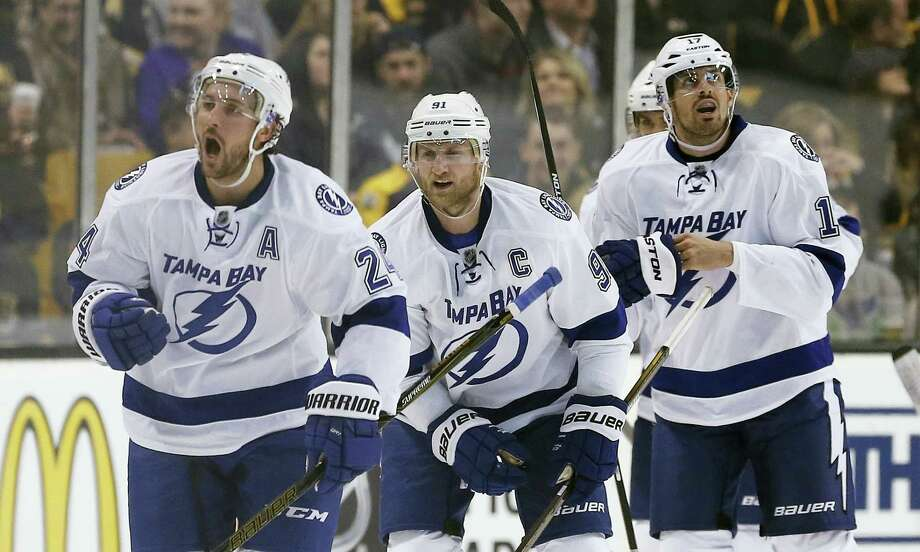 The Associated Press Tampa Bay Lightning's Ryan Callahan (24) celebrates his goal in front of teammates Steven Stamkos (91) and Alex Killorn (17) during the second period Sunday. Photo: AP / Copyright 2016 The Associated Press. All rights reserved. This material may not be published, broadcast, rewritten or redistributed without permission.