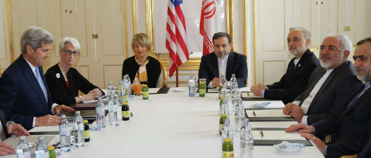U.S. Secretary of State John Kerry, left, and U.S. Under Secretary for Political Affairs Wendy Sherman, 2nd left, meet with Iranian Foreign Minister Mohammad Javad Zarif, 2nd right, at a hotel in Vienna, Tuesday June 30, 2015. Talks continued Tuesday on Iran's nuclear programme. (Carlos Barria/Pool, via AP)