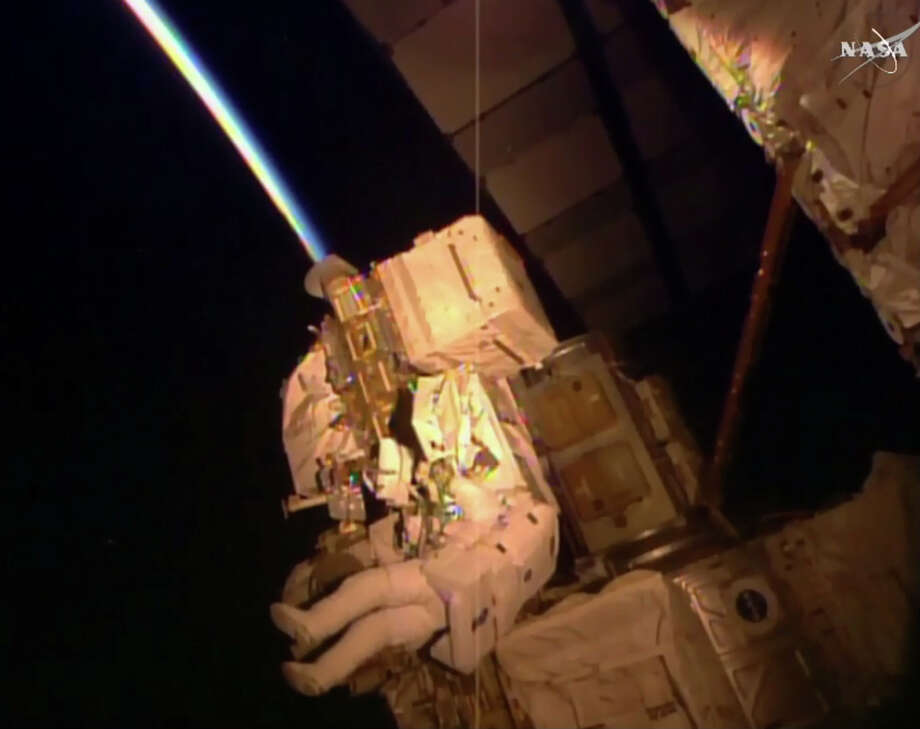 In this frame grab from NASA Television, astronaut Kjell Lindgren performs maintenance outside the International Space Station, Wednesday, Oct. 28, 2015. Lindgren and fellow astronaut Scott Kelly's to-do list included greasing the station's big robot arm, routing cables, removing insulation from an electronic switching unit and covering an antimatter and dark matter detector. Photo: NASA Via AP   / NASA