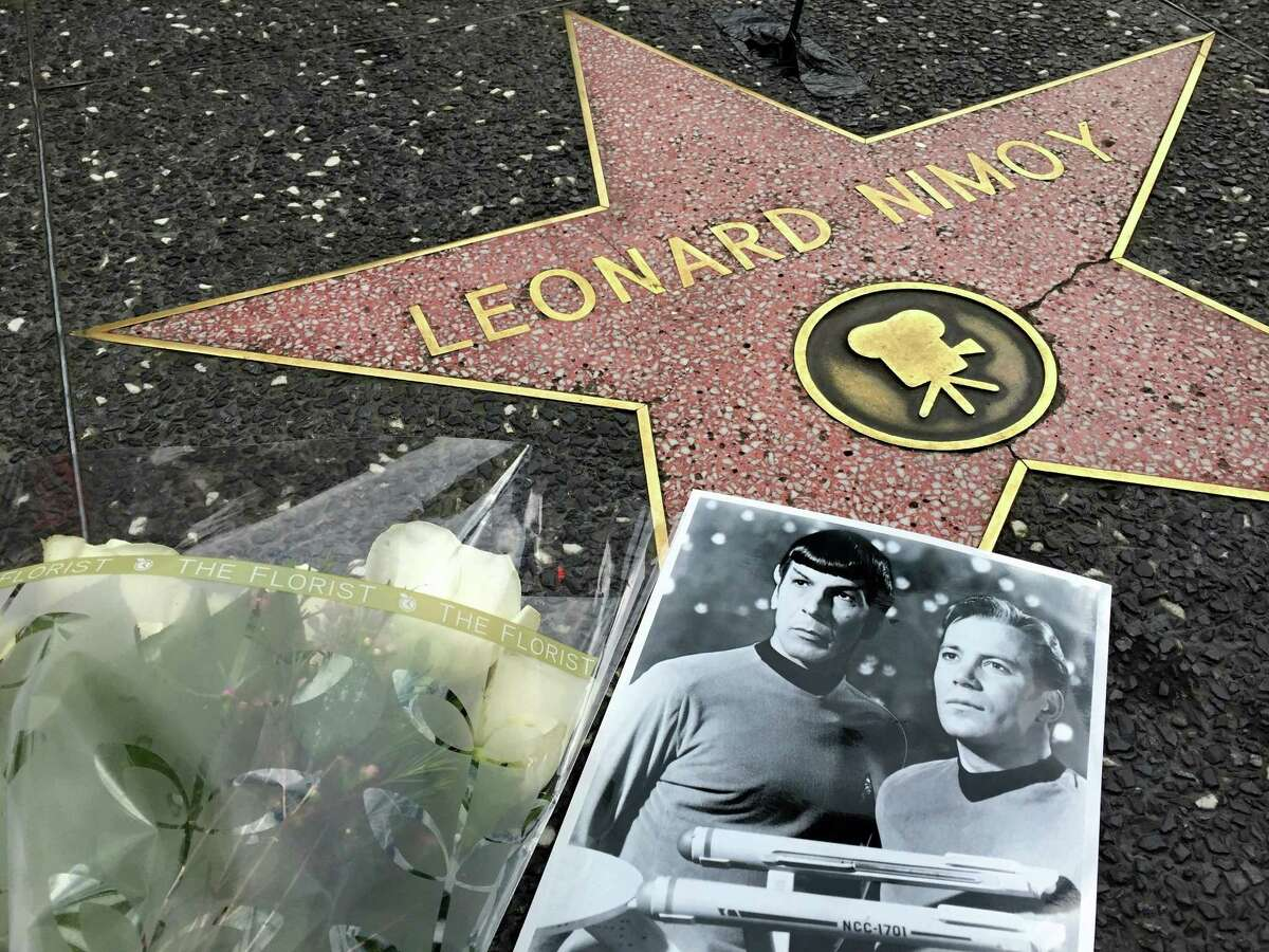 Flowers adorn the Hollywood Walk of Fame star of Leonard Nimoy in Los Angeles Friday, Feb. 27, 2015. Nimoy, famous for playing officer Mr. Spock in ìStar Trekî died Friday, Feb. 27, 2015 in Los Angeles of end-stage chronic obstructive pulmonary disease. He was 83. (AP Photo/Damian Dovarganes)