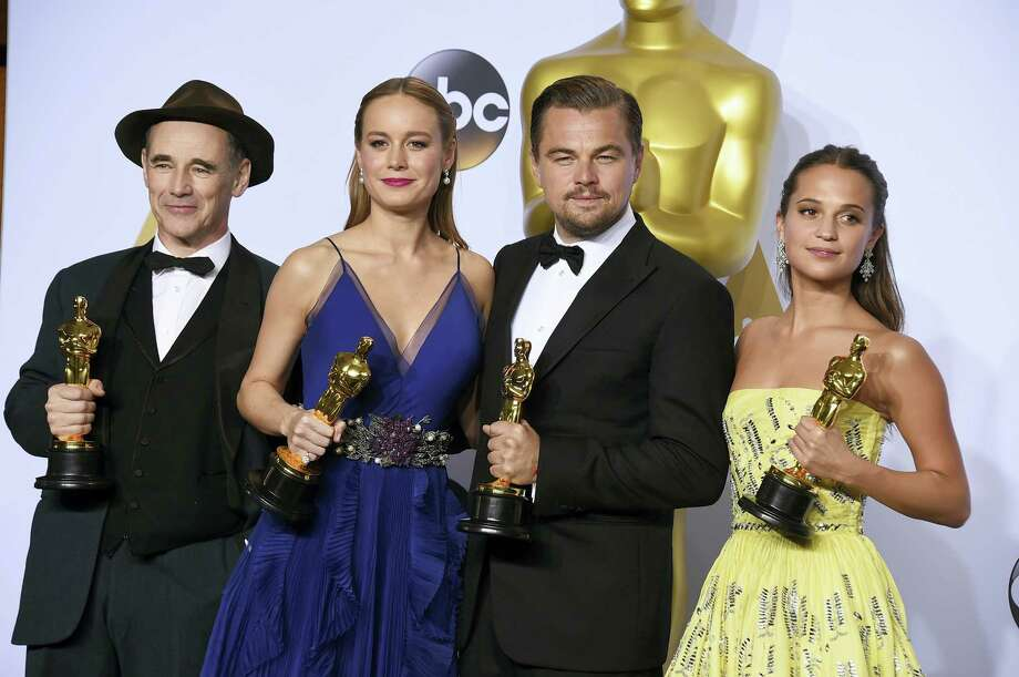 """Mark Rylance, winner of the award for best actor in a supporting role for """"Bridge of Spies,""""  from left, Brie Larson, winner of the award for best actress in a leading role for """"Room"""", Leonardo DiCaprio, winner of the award for best actor in a leading role for """"The Revenant"""", and Alicia Vikander, winner of the award for best actress in a supporting role for """"The Danish Girl"""" pose in the press room at the Oscars on Sunday, Feb. 28, 2016, at the Dolby Theatre in Los Angeles. (Photo by Jordan Strauss/Invision/AP) Photo: Jordan Strauss/Invision/AP / Invision"""