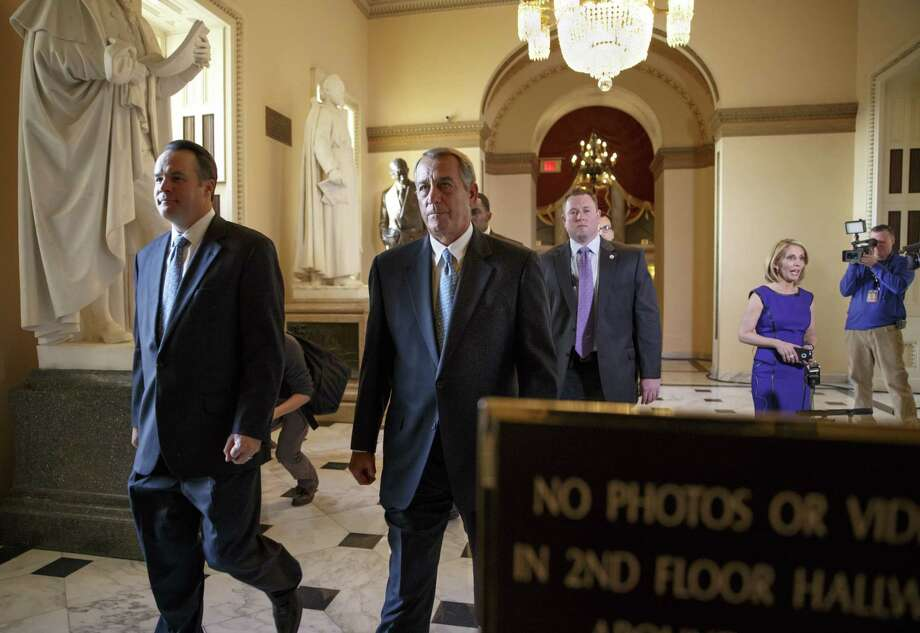 Speaker of the House John Boehner, R-Ohio, walks to the chamber as the House failed to advance a short-term funding measure to keep the Department of Homeland Security funded past a midnight deadline, at the Capitol in Washington, Friday evening, Feb. 27, 2015. Conservatives in Speaker Boehner's own party fought against three-week funding measure because it would not overturn Obamaís actions on immigration.  (AP Photo/J. Scott Applewhite) Photo: AP / AP