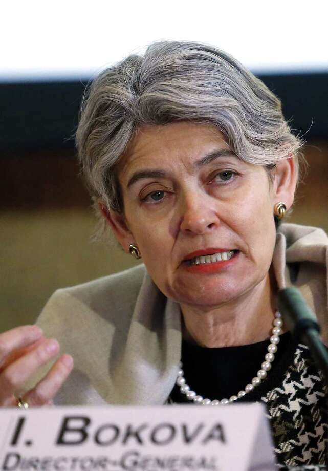 "Irina Bokova, Director General of the U.N.'s culture agency UNESCO, speaks during a press conference in Paris, France, Friday, Feb. 27, 2015. Bokova asked for an emergency meeting of the U.N. Security Council to be convened ""on the protection of Iraq's cultural heritage as an integral element for the country's security"" after extremists released a video thought to show men using sledgehammers to smash ancient Mesopotamian statues and other artifacts in Iraq's northern city of Mosul.(AP Photo/Jacques Brinon) Photo: AP / AP"