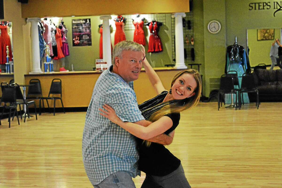 Winsted Town Manager Dale Martin practices his routine with instructor Amy Wylie.
