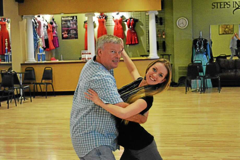 Winsted Town Manager Dale Martin practices his routine with instructor Amy Wylie. Photo: Ryan Flynn — Register Citizen