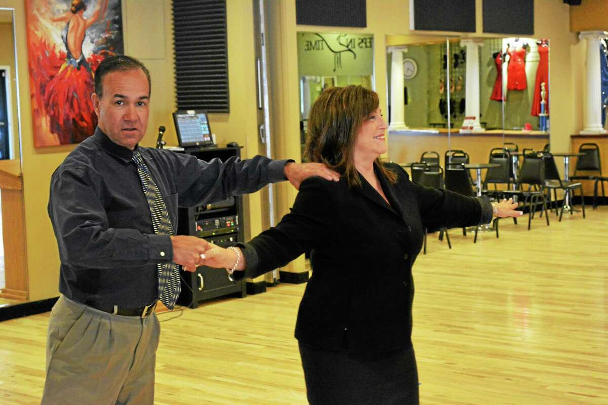 Eddie Salgado of Steps in Time trains his latest pupil, Sandra Conforti.