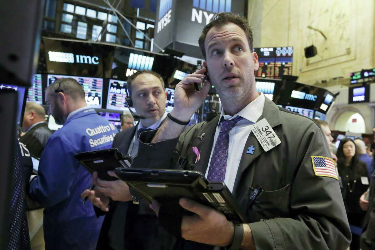 Trader Thomas Cicciari, right, works on the floor of the New York Stock Exchange Friday.