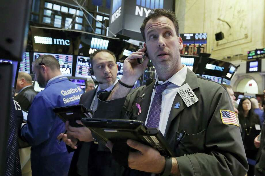 Trader Thomas Cicciari, right, works on the floor of the New York Stock Exchange Friday. Photo: Richard Drew — The Associated Press  / Copyright 2016 The Associated Press. All rights reserved. This material may not be published, broadcast, rewritten or redistribu