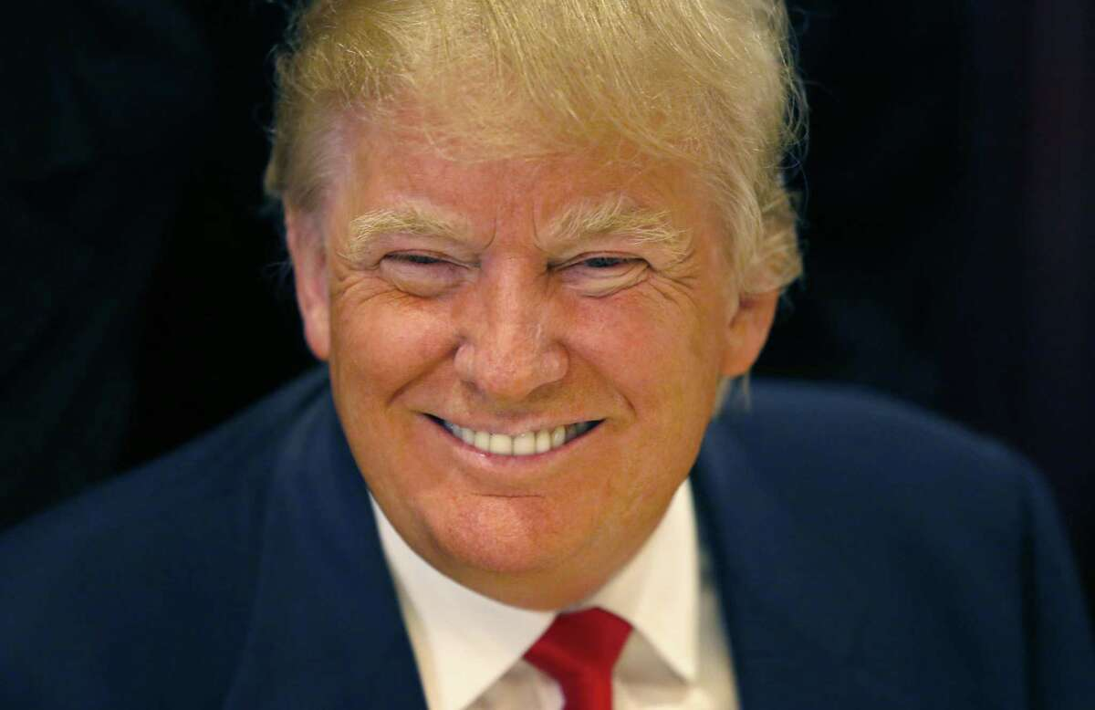 Republican presidential candidate Donald Trump smiles for a photographer before he addresses members of the City Club of Chicago, Monday, June 29, 2015, in Chicago. (AP Photo/Charles Rex Arbogast)