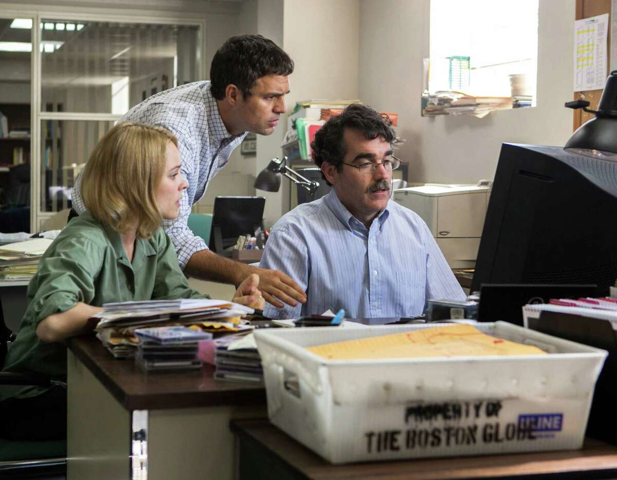 """This photo provided by Open Road Films shows, Rachel McAdams, from left, as Sacha Pfeiffer, Mark Ruffalo as Michael Rezendes and Brian d'Arcy James as Matt Carroll, in a scene from the film, """"Spotlight."""" (Kerry Hayes/Open Road Films via AP)"""
