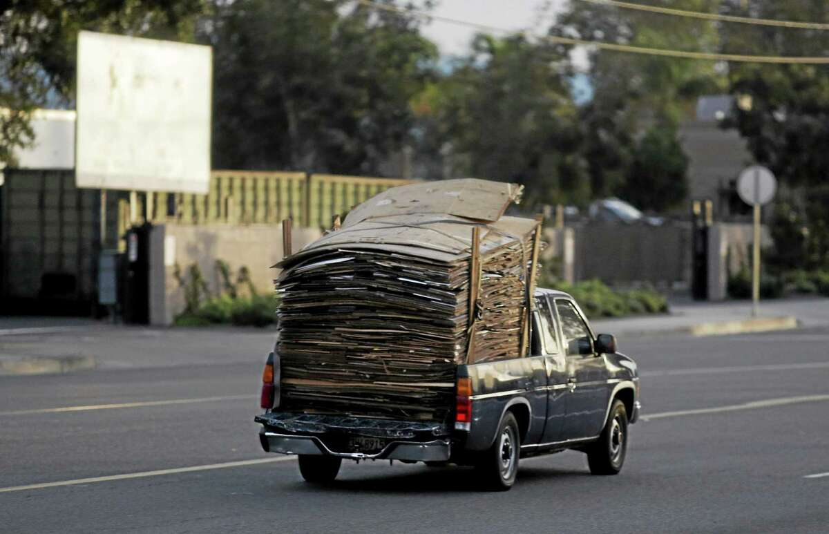 A truck loaded with Cardboard heads into a Southern California recycling center.