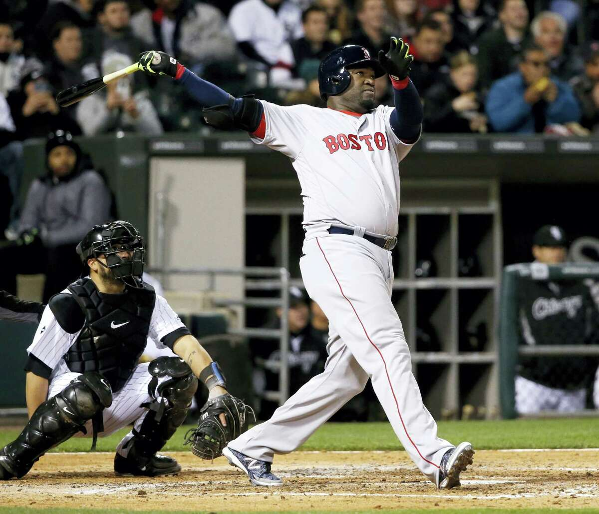 Boston Red Sox's David Ortiz watches his two-run home run off Chicago White Sox starting pitcher Carlos Rodon, also scoring Xander Bogaerts, during the fifth inning of a baseball game Wednesday, May 4, 2016, in Chicago. Watching with Ortiz is catcher Dioner Navarro. (AP Photo/Charles Rex Arbogast)