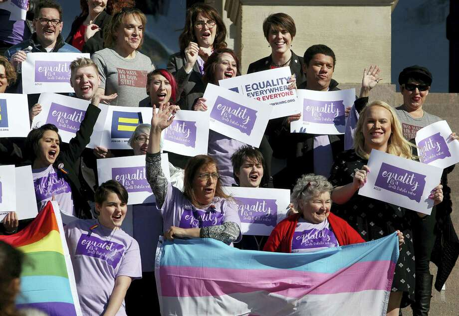 Representatives from the Center for Equality, American Civil Liberties Union of South Dakota, LGBT supporters and members of the Human Rights Campaign stand on the front steps of the State Capitol to honor Trans Kids Support Visibility Day in Pierre, S.D. on Feb. 23. Photo: The Argus Leader Via AP  / The Argus Leader
