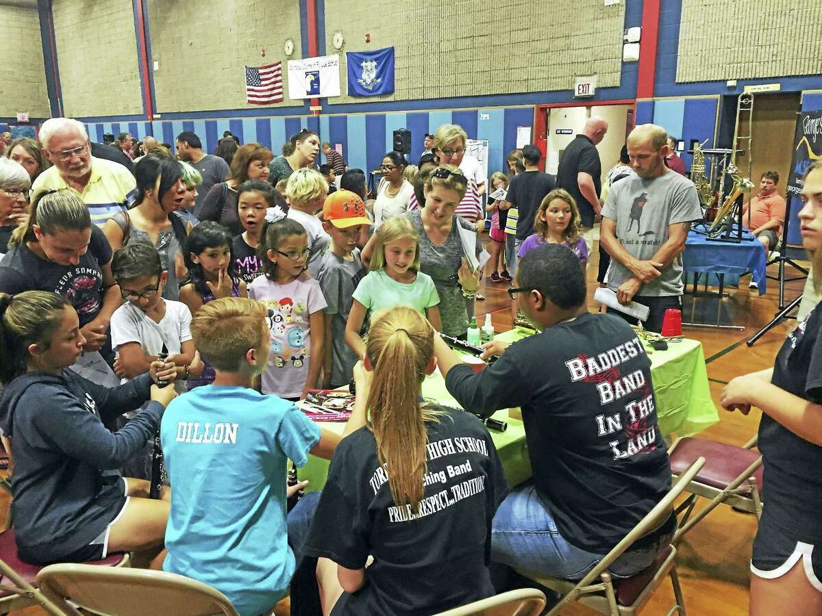 """CONTRIBUTED PHOTO Many of Torrington's younger students had the opportunity to try their hand at making music Thursday, as an """"instrument petting zoo"""" was held at Forbes School. The event was held to educate them on the music programs offered in the city's public school system."""