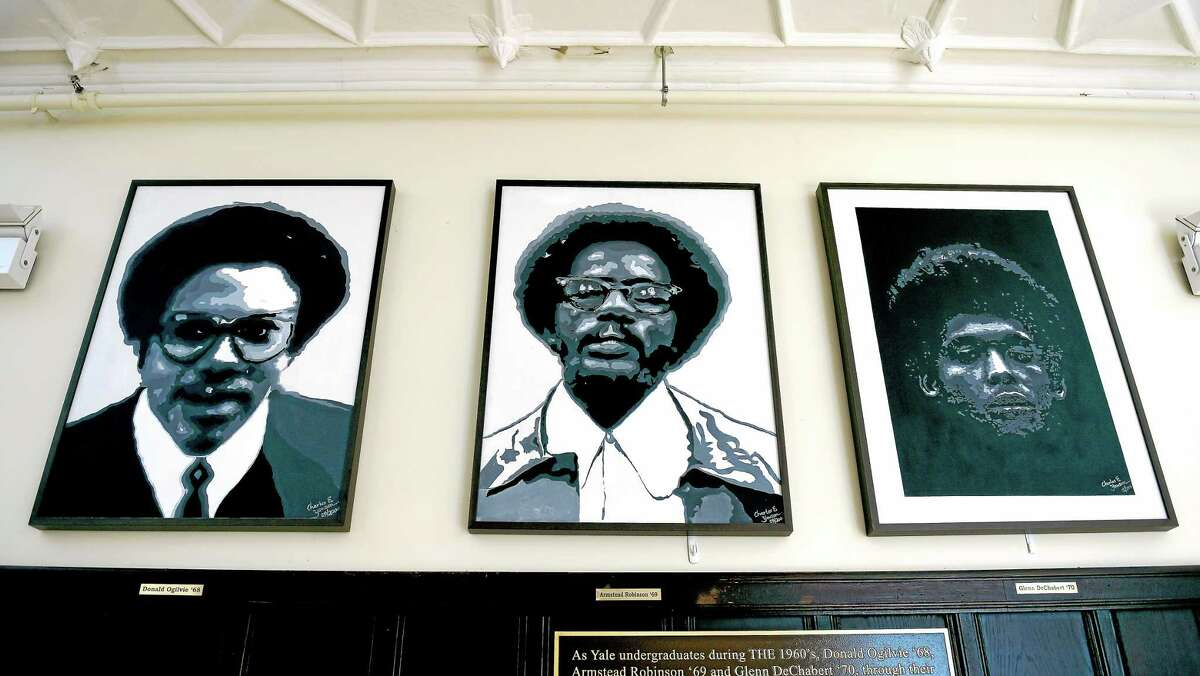 (Arnold Gold-New Haven Register) Left to right, portraits of three of the founders of the Afro-American Cultural Center at Yale, Donald Ogilvie, Armstead Robinson and Glenn DeChabert, hang in the Founders Room of the center on Park Ave. in New Haven on 2/26/2015.
