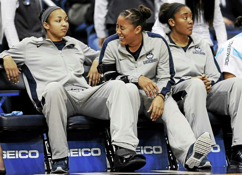 UConn's Kaleena Mosqueda-Lewis, center, and Kiah Stokes, left, will be honored at Senior Day on Saturday. At right is Morgan Tuck. Photo: Jessica Hill — The Associated Press File Photo  / AP2013