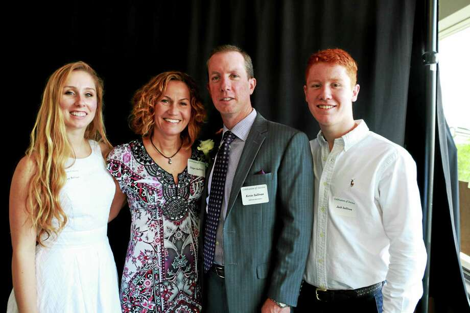 Recipient Kevin Sullivan, with his wife Ginger and kids Lacey and Jack. Photo: John Fitts — The Register Citizen